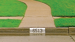 curb address numbers on a sidewalk